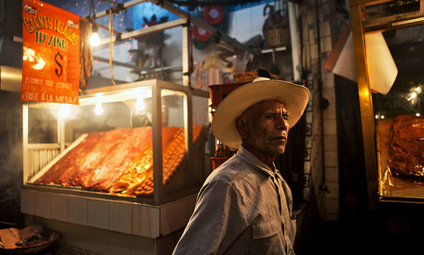 A meat stall at Mercado 20 de Noviembre, a smoke-filled alley lined with carne asada vendors. More Photos »